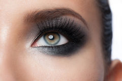 Eye makeup. Closeup of beautiful woman eye with bright stylish makeup with long lashes Royalty Free Stock Photo