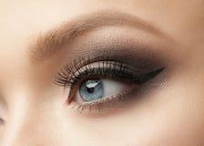 Eye Makeup. Closeup of beautiful woman eye with makeup, eyeliner Stock Photos