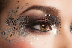 Eye Makeup. Closeup of Beautiful Woman Eye with Glitter Makeup. Fancy Makeup, False Eyelashes Royalty Free Stock Photos