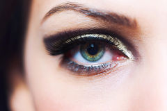 Eye makeup. Closeup of a beautiful young woman's eye with makeup royalty free stock image