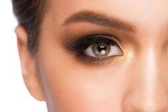 Eye makeup. Closeup image of beautiful woman eye with fashion bright makeup Stock Photos