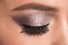Eye makeup. Closeup image of beautiful woman eye with fashion bright makeup royalty free stock photos