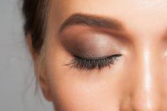 Eye makeup. Closeup image of closed woman eye with beautiful bright makeup, smoky eyes Royalty Free Stock Photo