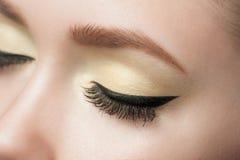 Eye makeup. Closeup of woman eye with beautiful makeup with black eyeliner Royalty Free Stock Photos