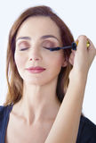 Eye makeup. Eyes makeup applying mascara, beauty portrait of a young woman Royalty Free Stock Images