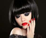 Eye makeup. Fashion Beauty Brunette Woman Portrait. Red lips and Royalty Free Stock Image