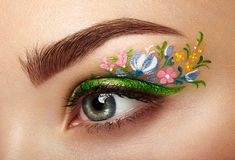 Eye makeup girl with a flowers Stock Image