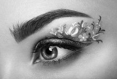 Eye makeup girl with a flowers Royalty Free Stock Photography