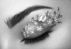 Eye makeup girl with a flowers Royalty Free Stock Images