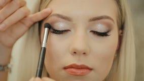 Eye makeup woman applying eyeshadow powder. Beautiful woman face. Perfect makeup. Beauty fashion. Eyelashes. Cosmetic Eyeshadow