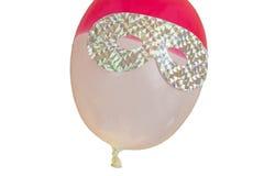 Eye mask on party balloon Royalty Free Stock Photos