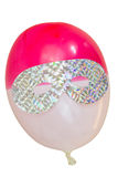 Eye mask on party balloon Royalty Free Stock Images