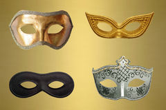 Eye Masks. A set of four party eye masks on a golden background Royalty Free Stock Image
