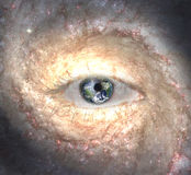 Eye in midst of Galaxy with Earth Stock Photography