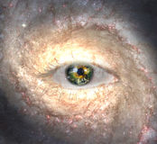 Eye in midst of Galaxy with Earth Reflection Royalty Free Stock Image