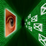 An eye monitoring emails and binary code. An eye monitoring a corridor of emails and binary code Royalty Free Stock Photography