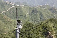 Eye on the mountain. Security camera on Great Wall of China Stock Images