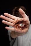 Eye na mão - conceito da visão e da identidade Imagem de Stock