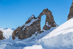 Eye of the Needle. L'Aiguille Percee or Eye of the Needle is a spectacular rock formation in the French Alps, near Tignes Royalty Free Stock Image