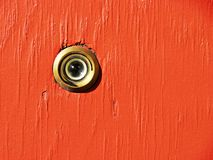 Eye peephole. Looking through hole in plank of wood Royalty Free Stock Photo