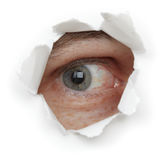 Eye of person in hole close up Stock Photos