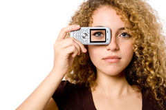 Eye on Phone. A young woman holding mobile phone to eye with picture of eye on phone stock images