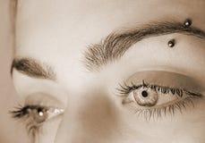 Eye pierce stock photos