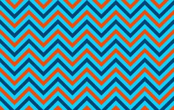 Eye-pleasing abstract chevron lines in orange, blue and light blue. Horizontal graphic resource: abstract background with symmetrical pattern, textile print stock illustration