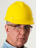Eye Protection, Safety Glasses, Accident, Industrial. A serious eye injury and industrial accident was prevented because a blue collar factory worker was wearing stock photography