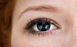 Eye with radiation hazard symbol. Stock Photo