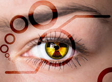 Eye with radiation symbol. Royalty Free Stock Images