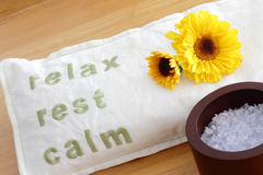 Eye Relaxation. Spa products like a scented bag for eye stress relief with the words relax, rest, calm on it with flowers and bath salt nearby part of a Stock Image