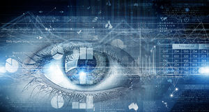 Eye scanning. Concept image. Close up of human eye on digital technology background royalty free stock photo