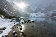 Eye of the Sea lake in Tatra mountains at winter. Beautiful winter in Tatra mountains at Eye of the Sea lake, Poland Stock Photography