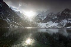 Eye of the Sea lake in Tatra mountains at winter. Beautiful winter in Tatra mountains at Eye of the Sea lake, Poland Stock Photos