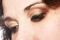 Eye shadow. Female eye with golden-brown cosmetic make-up Royalty Free Stock Images
