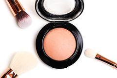 Eye shadow, blush, powder, sculptor in a pack with make up brushes on a white background. Isolated on white. Image stock photography