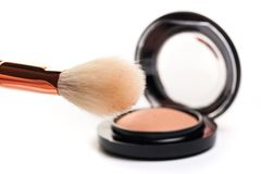 Eye shadow, blush, powder, sculptor in a pack with make up brushes on a white background.  on white. Image stock photo