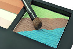 Eye shadow and a brush. Make up eye shadow and a brush Royalty Free Stock Photos