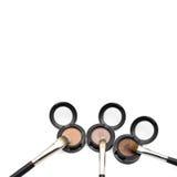 Eye shadow brushes on eye shadow pots Royalty Free Stock Photo