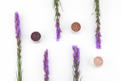 Eye shadow glitter set decorated with violet liatris flowers Stock Photo