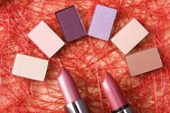 Eye shadow and lipsticks Royalty Free Stock Photography