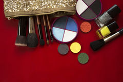 Eye shadow, makeup brushes  on red Stock Photos