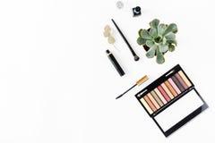 Eye shadow, mascara, nail polish, Flat lay makeup table concept. Eye shadow, mascara, nail polish on a white background, top view. Flat lay makeup table concept royalty free stock images