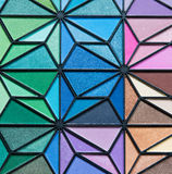 Eye Shadow. Multiple bright colors of eye shadow in a trianglular design Royalty Free Stock Photo