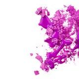 Eye shadow with nail polish. Crushed eye shadow with purple nail polish isoalted on white background stock image