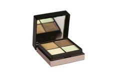 Eye shadow in open box with mirror. Eye shadow in open black box with mirror Royalty Free Stock Photography