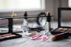 Eye shadow and other cosmetics on background. Daily cosmetics on table royalty free stock image