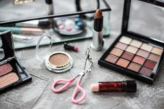 Eye shadow and other cosmetics on background. Daily cosmetics on table stock photo