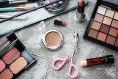 Eye shadow and other cosmetics on background. Daily cosmetics on table stock photography